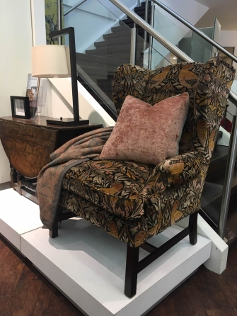 Columbia wing chair covered in Jim Dickins Fabric, Milongo collection, Ruskin, colour Autumn